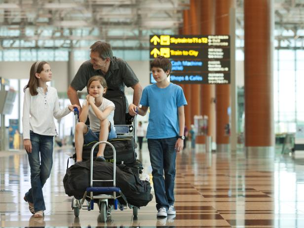 Family with luggage in the airport