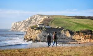 Fresh Start Walking Weekend, Isle of Wight. Two walks stroll on a path near the coast.