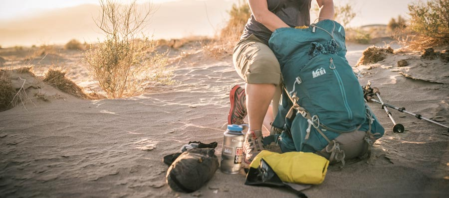 a female backpacker packing her pack