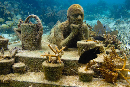 The statues are slowly forming a coral reef
